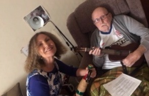 client with caregiver and guitar