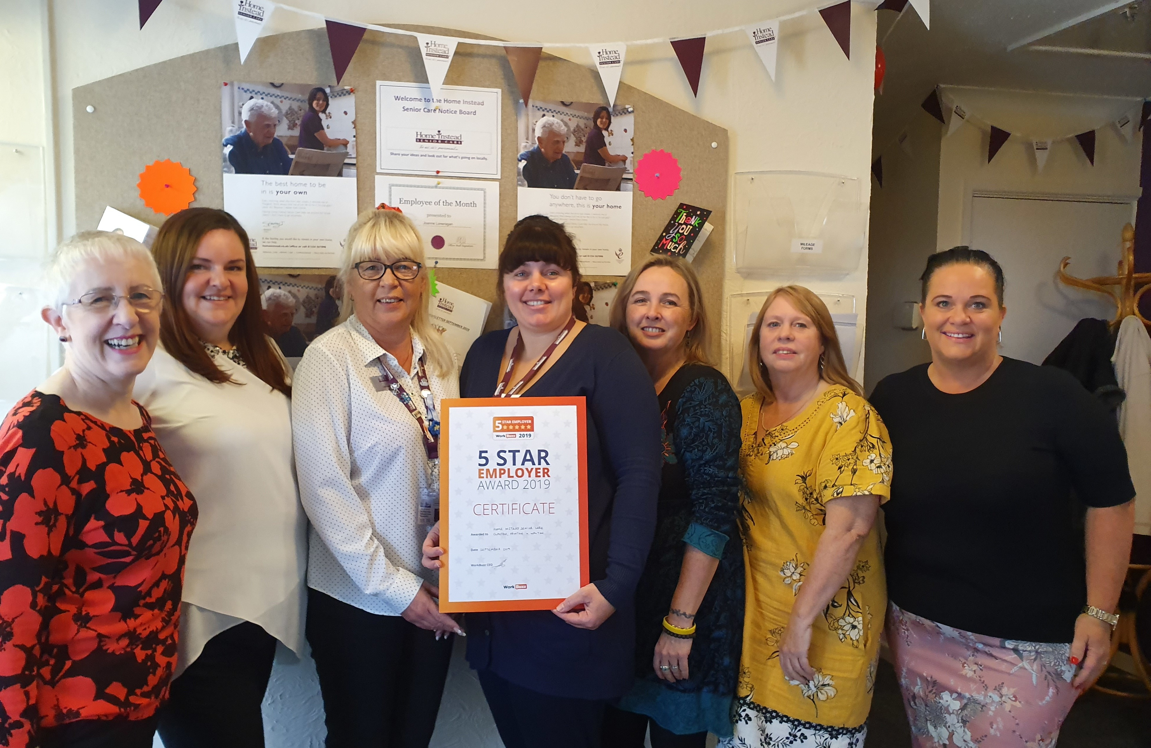 Office team with 5 Star Award from WorkBuzz