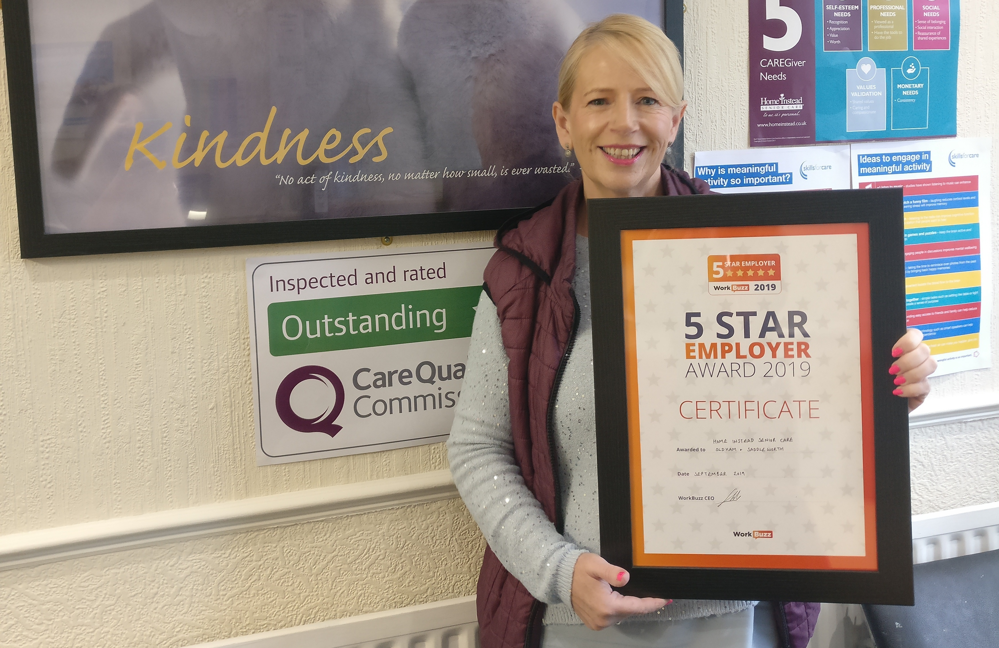 BDM Bobbie holding the Certificate