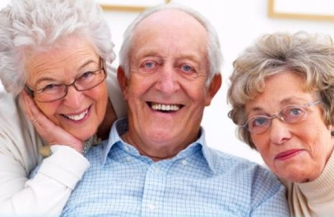 Photo of happy elderly ladies and gentleman