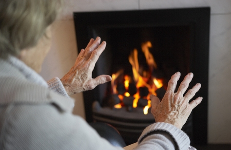 older person warming hands